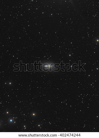 This is a picture of spiral galaxy NGC3675. It is located about 46 million light years away in the constellation Ursa Major. - stock photo