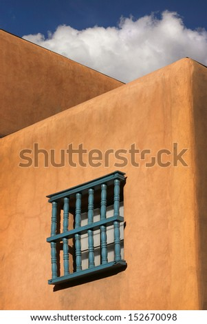 This is a simple architectural study under the warm sunlight and clear skies of Santa Fe New Mexico in early spring. - stock photo