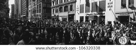 This is a Ticker Tape Parade for the New York Yankees. This is celebrating that they were the 1998 World Champions. The parade goes through the Canyon of Heroes. - stock photo