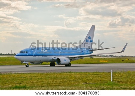 This is a view of KLM Group plane Boeing 737 registered as PH-BGI on the Warsaw Chopin Airport. July 30, 2015. Warsaw, Poland.