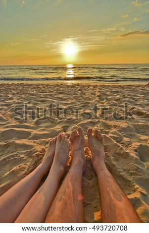 This is a view of romantic sunset by the Baltic Sea in Poland.