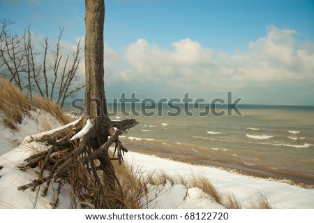 This is a winter scene on top of Mount Baldy in the Indiana Dunes National Lakeshore. Mt. Baldy, the giant sand dune, is moving at an alarming rate away from the lakeshore and towards the main highway - stock photo