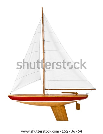 This is a wooden toy sailboat ready to put in the water and play. - stock photo