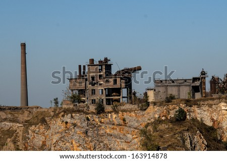 This is an abandoned cement factory. - stock photo