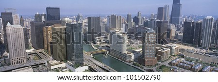 This is an aerial view of the Chicago River and the surrounding skyline in summer. - stock photo