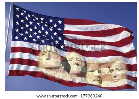 This is an American flag waving in the wind set on a flagpole against a blue sky. The four presidents of the Mt. Rushmore National Monument. - stock photo