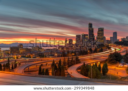 This is an epic sunset over Seattle skylines/downtown in summertime. The view is from Rizal Bridge, a prominent viewpoint for gorgeous sunset in Seattle. Cityscape, busy, rush hour, high speed concept - stock photo