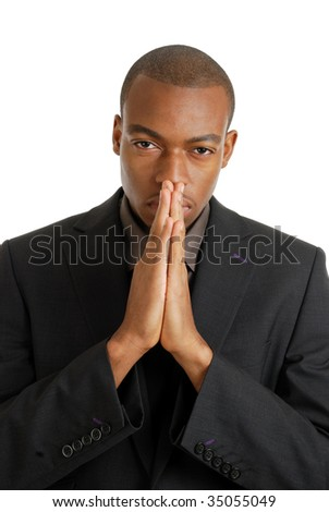 This is an image of a business man praying, using prayer gesture eyes opened.