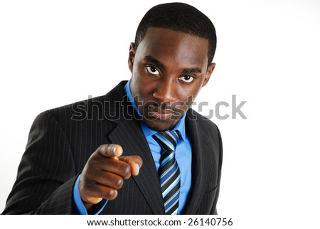 This is an image of a confident business man pointing. - stock photo