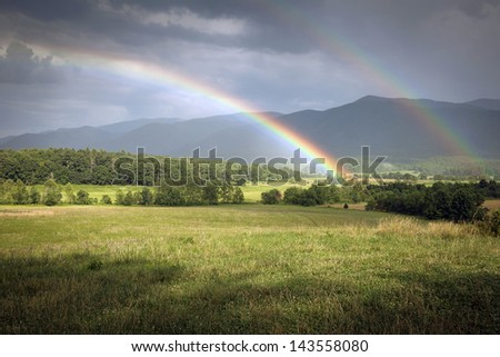 This is an image of a dual rainbow over the Cades Cove section of the Great Smoky Mountain National Park.