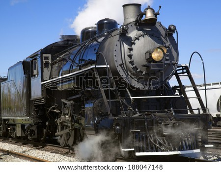 This is an image of an old steam locomotive still in service. - stock photo