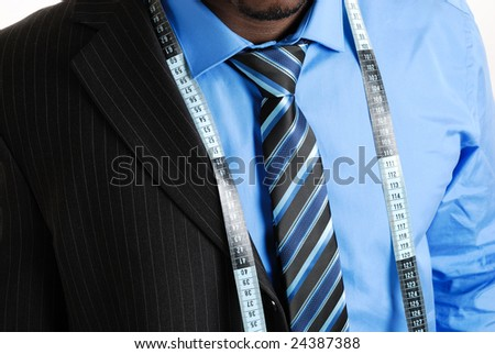 This is an image of business man wearing a tape measure across his suit and shirt. Fashion concept. - stock photo
