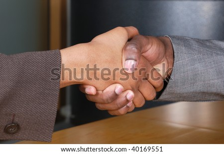 This is an image of male and female handshake at a business reception.