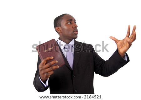 "This is an image of man holding a bible. This image can be used to represent ""sermon"", ""preaching"" etc... - stock photo"