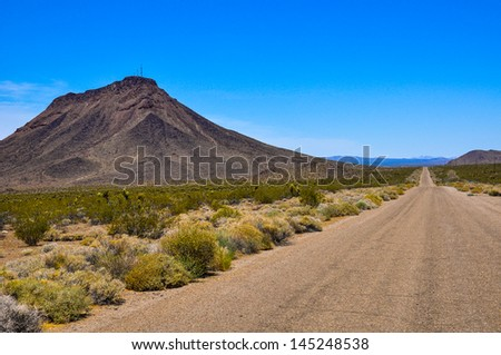 This is an unmaintained part of the route 66 in the Mojave desert - stock photo