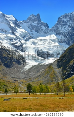 This is autumn valley in Caucasus mountains - stock photo