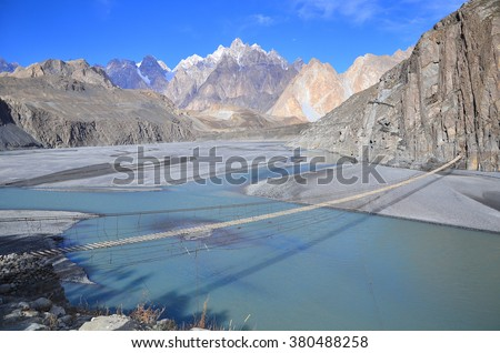 This is Cathedral Ridge viewed from the Karakoram Highway near the village of  Hussaini, Upper Hunza valley, Gilgit-Baltistan Pakistan with the suspension bridge foreground. - stock photo