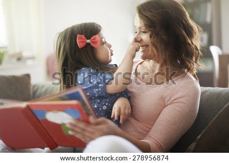 This is family time for reading a book  - stock photo