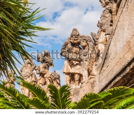This is famous grotesque statues with human faces that decorate garden and wall of the Villa Palagonia (The Villa of Monsters) near Palermo, Sicily, Italy.  - stock photo