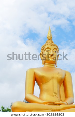 This is Gold Buddha statue in the asian temple, With sky background.