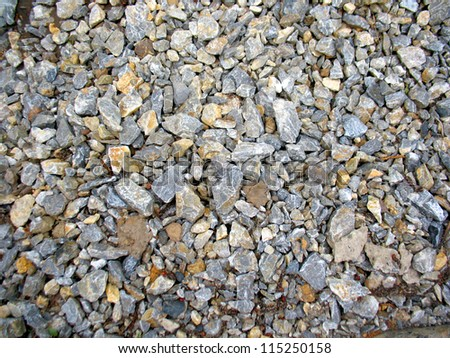 This is heap of grey acute stones