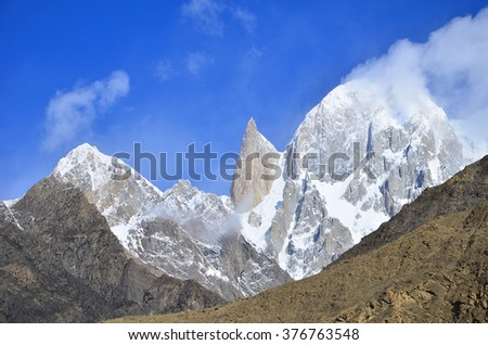 This is lady finger peak with blue sky in hunza valley karakoram range Pakistan - stock photo
