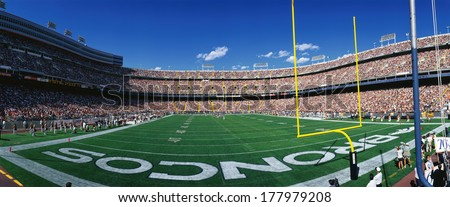 This is Mile High Stadium and the game is the Denver Broncos vs. the St. Louis Rams. It is a sold out NFL game that took place on 9/14/97. - stock photo