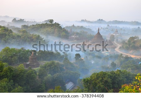 This is Mrauk-U pagoda , Myanmar from top view with the mist in the evening time  - stock photo