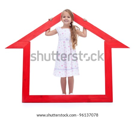 This is my new home - happy little girl with house shaped frame - stock photo