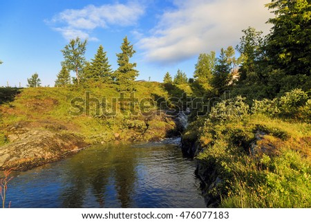 This is one of the many streams with clean drinking water in rural areas of Norway in the early morning.