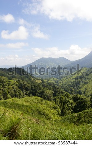 This is part of the landscapes available while trekking through the Colombian jungle towards Ciudad Perdida. - stock photo