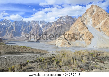 This is Passu Cathedral viewed in spring from the Karakoram Highway near the village of Passu, Upper Hunza valley ,northern Pakistan - stock photo