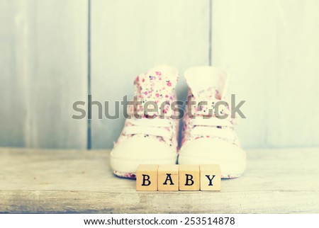 This is photo of baby girl shoes - stock photo