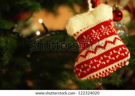 This is photo of christmas sock on xmas tree - stock photo