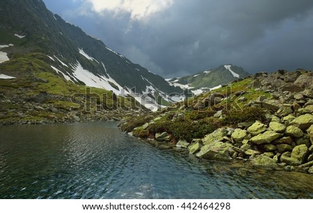 This is somber evening in Caucasus mountains in summer - stock photo