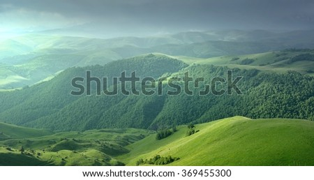 This is somber morning in Caucasus mountains in summer - stock photo
