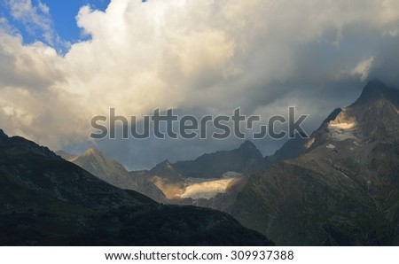 This is stormy morning in Caucasus mountains in summer - stock photo