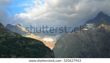This is stormy morning in Caucasus mountains in summer