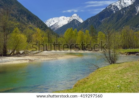 This is sunny landscape in Caucasus mountains in spring - stock photo