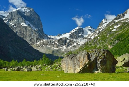 This is sunny valley in Caucasus mountains in summer - stock photo