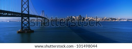 This is the Bay Bridge and skyline in morning light. - stock photo