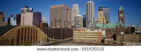 This is the compact skyline of Minneapolis in daylight. - stock photo
