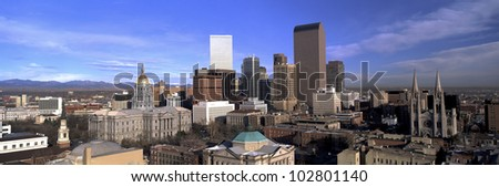 This is the Denver skyline, State Capitol and Rocky Mountains. It shows morning light on what is known as the Mile High City. - stock photo