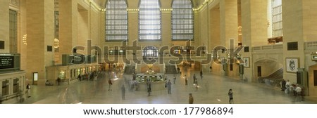 This is the interior of Grand Central Station after its new renovation. There are commuters going to their trains and monitors showing the train times. - stock photo