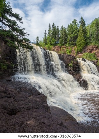 This is the Middle Falls at Gooseberry Falls State Park in Minnesota. This is in the Lake Superior North Shore Area. - stock photo