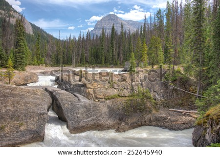 This is the Natural Land Bridge near Field, B.C. It spans the Kicking Horse River in Yoho National Park, British Columbia, Canada. - stock photo