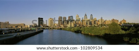 This is the Philadelphia skyline from the Schuylkill River at sunset. - stock photo