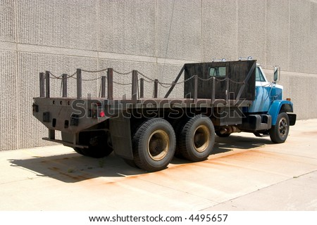 This is the rear view of a large flat bed straight truck.