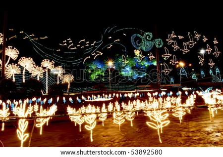 This is the river that runs through Medellin Colombia.  During Christmas they decorate the river with illuminated lights from clouds to flowers and are not Christmas themed. - stock photo