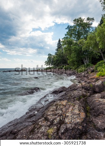 This is the shore of Lake Superior in Lutsen, Minnesota. - stock photo